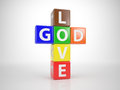 God and love out of letterdices multicolored dices in form a christian cross with the words Stock Image