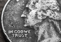 In god we trust beat up quarter Royalty Free Stock Photo