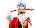 God of wealth holding a compute machine and chinese currency over white background Stock Image