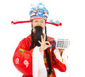 God of wealth holding a compute machine over white background Royalty Free Stock Photos