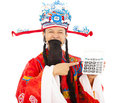 God of wealth pointing a compute machine over white background Stock Photo