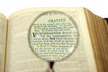 The god word comes bigger under magnifier on a bible page Stock Photo
