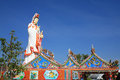 Goddess of Mercy statue behind Chinese temple Stock Images