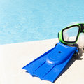 Goggles and flippers for swimming pools or sea diving lying by the pool Stock Photos