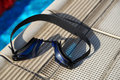 Goggles for swimming on a pool side