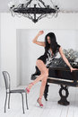 Gogo dancer in a black suit with a silver arrow room piano Royalty Free Stock Photo