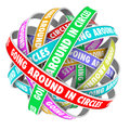 Going around in circles words on circle ribbons the colorful stuck an endless repetitive circular pattern to illustrate being lost Royalty Free Stock Photo