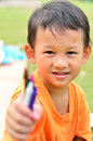 Going back to school little boy holding color pens close up Stock Photo