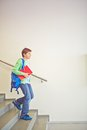 Going downstairs pre teen schoolboy with backpack Stock Image