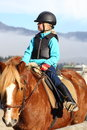 Going on horseback young girl is in nature Royalty Free Stock Image