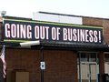 Going out of business sign building with Stock Photography