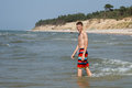 Going for a swim teen boy at wild beach Stock Photos