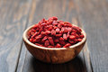 Goji berries wooden bowl with on the table closeup Stock Images