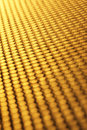 Gold abstract background dotted with narrow focus Royalty Free Stock Photos