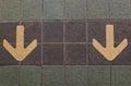 Gold arrow on ground Stock Photo