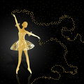 Gold ballerina on dark background.