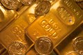 Gold bars and coins close up of old Royalty Free Stock Photo