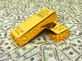 Gold bars on dollars Royalty Free Stock Photo