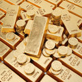 Gold bars and gold coins Royalty Free Stock Photo