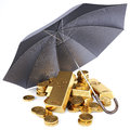 Gold bars and gold coins under umbrella Stock Photography