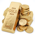 Gold bars and gold coins on white Royalty Free Stock Photo