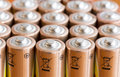 Gold batteries in rows with silver mutiple tops closeup Royalty Free Stock Photography