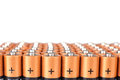 Gold batteries in rows with silver tops close up Royalty Free Stock Photos