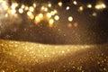 Gold and black glitter vintage lights background. defocused Royalty Free Stock Photo