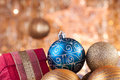 Gold and blue christmas baubles and red box Royalty Free Stock Photo