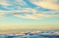 Gold and blue colors clouds abstract background. Sunset sky above the clouds.