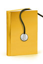 Gold book of medical clipping path a golden cover hardcover with for maximum size Royalty Free Stock Photos