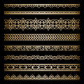 Gold borders set of vintage ornamental dividers isolated on black Stock Photos