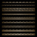 Gold borders set of vintage wavy ornamental dividers on black Royalty Free Stock Photography