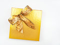 Gold Box & Bow Royalty Free Stock Photo