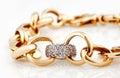Gold bracelet with diamonds Royalty Free Stock Photo