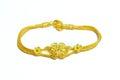 Gold bracelet isolated on white Royalty Free Stock Photo