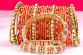 Gold bracelets and bangles Royalty Free Stock Photo