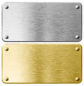 Gold or brass metal plaque with rivets isolated Royalty Free Stock Photo