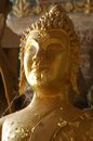 Gold buddah head with cobwebs in ancient temple cave Stock Photo