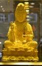 Gold buddha statue of avalokitesvara in gold shop buddhist bodhisattva avalokiteshvara sculpture goddess of mercy is a who Royalty Free Stock Images