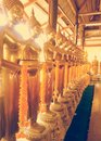 Gold buddha statue the row of Stock Image