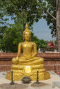The gold buddha statue sitting with candlestick and incense burner Royalty Free Stock Photo