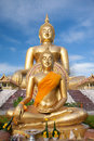 Gold buddha statue under construction in thai temple with clear sky wat muang ang thong thailand Royalty Free Stock Images