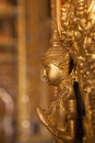 Gold buddha statue on the wall in church at buddhist temple in T Royalty Free Stock Photo