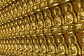 Gold Buddha temple wall Royalty Free Stock Images