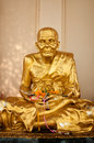 Gold buddhist monk statue in temple ko samui thailand Royalty Free Stock Images