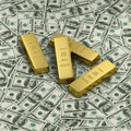 Gold bullion or four ingots on US dollar banknotes Royalty Free Stock Image
