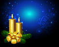 Gold candles and starry sky illustration of golden christmas with bow blue background with copy space Stock Photography