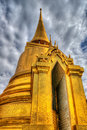 Gold chedi at the temple of the emerald buddha at the grand palace bangkok thailand Stock Photos