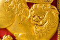 Gold Chinese lion on the red wood door Royalty Free Stock Photo